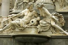 mythology fountain on the front of Vienna parliament - stock photo