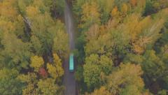 Bus goes through the beautiful forest, aerial shooting Stock Footage