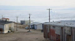 People riding bikes and four-wheelers on the shoreline of Pond Inlet. Stock Footage