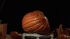 Slow motion shot of a person jumping on a pumpkin and smashing. Stock Footage