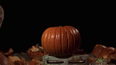 Slow motion shot of a pumpkin being smashed by a cinder block. Stock Footage