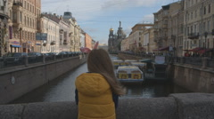 Girl looks at the city and at the Church of the Savior on Spilled Blood, St.P Stock Footage