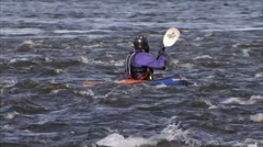 Kayaker in Gatineau rapids. (Pan) - stock footage