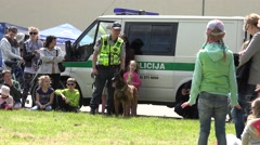 Police man performance with trained dog near police car. 4K Stock Footage