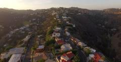 Stock Video Footage of Aerial panorama Hollywood Hills at sunset Pan left Mt Olympus toward Los Angeles