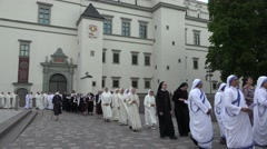 Nun sister and monks march in religious procession near cathedral. 4K Stock Footage