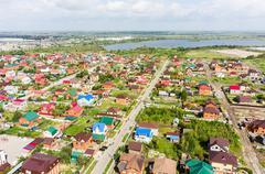 Aerial view of houses on housing estates. Tyumen - stock photo