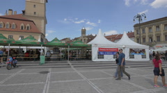 Outdoor restaurants on a sunny summer day in the Council Square, Brasov Stock Footage
