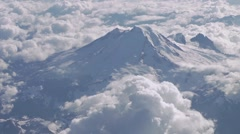 Aerial shot of the rocky mountains surrounded by clouds. - stock footage