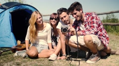 Handheld shot of friends taking photo at camp - stock footage