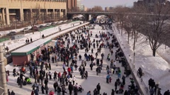 The Rideau canal filled with skaters during winterlude. Stock Footage