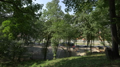 A basketball playground near Tiberiu Brediceanu alley and the forest, Brasov Stock Footage