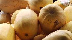 A bin of squash and gourds at a farmers market. (Pan) Stock Footage