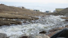 A stream flowing through Pond Inlet. Stock Footage