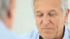 Senior man applying anti-aging lotion on his face Stock Footage
