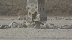 Hydraulic crushing hammer breaking concrete on an airport runway Stock Footage