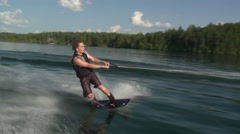 Wake-boarding man falls. - stock footage