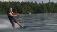 Man wake-boarding on a lake during summer. Stock Footage
