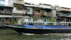 Stock Video Footage of Bangkok Canal Khlong boats in Thai, public transport in Old Town. Panning shot.