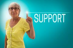 Support touch screen is shown by Senior Woman concept - stock photo