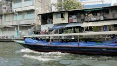 Bangkok Canal Khlong boats in Thai, public transport in Old Town. Panning shot. Stock Footage