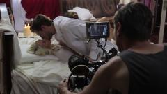 actors having sex in front of the camera of a cameraman.Film shooting - stock footage