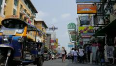 Traffic in Touristic Khao San Road, Bangkok, Thailand. Low angle view. Stock Footage