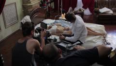 The cameraman shoots erotic film. Film shooting - stock footage