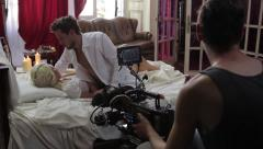The cameraman shoots erotic video with a guy and a girl. Film shooting - stock footage
