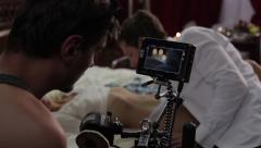 The cameraman shoots erotic film with actors. Film shooting Stock Footage