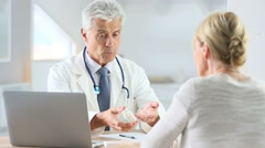 Doctor having consultation with patient in office - stock footage