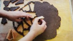 Cutting out gingerbread dough time lapse. Traditional Christmas cookies Stock Footage