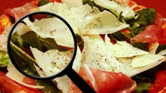 Magnifying glass on food - stock footage