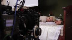 The camera shoots the girl and guy actors in bed. Film shooting - stock footage