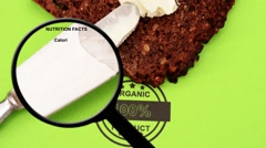 Magnifying glass on organic bread Stock Footage