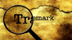 Magnifying glass on  trademark Stock Footage