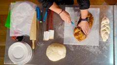 Chef slice Bread of shabat Stock Footage