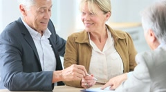 Senior couple meeting real-estate agent for investment - stock footage