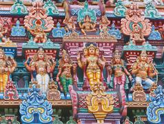 Sculptures on Hindu temple gopura (tower). Menakshi Temple, Madurai, Tamil Na Stock Photos