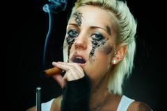 Closeup portrait of a beautiful young punk woman Stock Photos