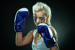 Beautiful agressive boxer girl - stock photo