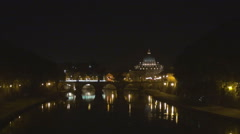 Illuminated Saint Peters cathedral night water reflection River Tiber Rome icon Stock Footage