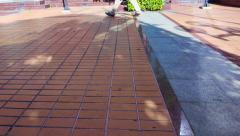 people leg walking across landscaping material floor. Urban park Walkways - stock footage