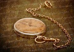 Time concept - vintage pocket watch with chain lying on rough green  surface  Stock Photos