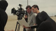 Director and cinematographer at work on shooting the film outdoors - stock footage