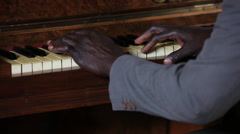 African man playing piano - stock footage