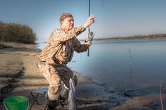 Fisherman at the river Stock Photos