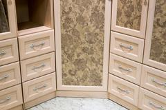 Fragment of beige cupboard with drawers - stock photo