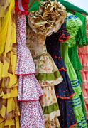 Stock Photo of Andalusian gipsy dresses in a row at Spain