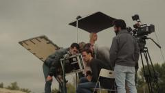 Film crews while filming in the desert. Shooting scenes of the movie. Film shoot Stock Footage